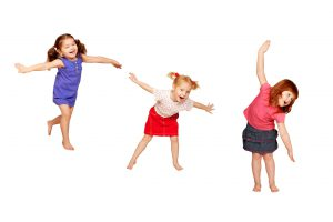 Happy dancing kids. Isolated on white